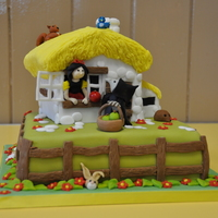 Snow White Maderia, buttercream and fondant Snow White cottage, adapted from a Debbie Brown cake.