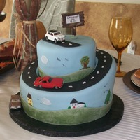 "Classic Cars This cake was made for an 80th birthday. The cards matched the saying at the top ""Cruising to 80"". Had painted accents on the..."