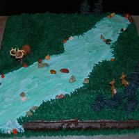"Deer Hunting 17"" sheet cake covered in chocolate syrup frosting and then decorated with buttercream. The trees and animals are from a kit. I really..."