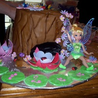 Tinkerbell At Home tree stump cake with gp flowers and lady bugs