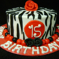 Zebra Cake Made for a friends daughter. Vanilla cake with Leah_S version of Charlottes whipped buttercream, fondant accents. Thanks for looking :)