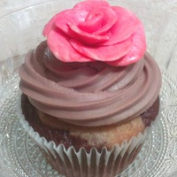 Pink Rose Marble cupcake with chocolate butter cream and a pink fondant rose.