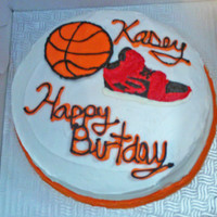 Basketbal & Sneaker This cake is a vanilla cake with vanilla buttercream icing.All decorations are made with colored chocolate.