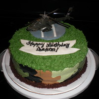 Helicopter Cake nephew's birthday cake. Wanted helicopter cake, which was a toy. The helicopter pad was fondant, and used buttercream icing. I used...