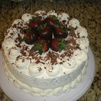 Chocolate Covered Strawberries The cake is frosted with whipped cream frosting, chocolate covered strawberries, and garnished with chocolate shavings. The cake is...