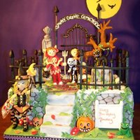 Spooky Grove Cemetery My grandson wanted a Halloween themed birthday cake. The cake is chocolate fudge and yellow cake with chocolate buttercream and mini...