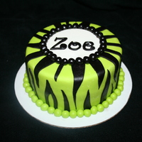 Lime Green Zebra Stripes 6in chocolate cake covered in fondant. Candy zebra striped sucker.