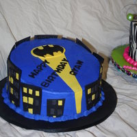 Batman Cake 10in rainbow colored WASC with strawberry filling. Buttercream with MMF accents.