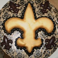 Fleur De Lis Chocolate cake with caramel bits. fondant with caramel added in. chocolate fleur de lis.