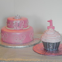 Fit For A Princess Friend wanted an ellegant princess cake for her baby girl. Used my cricut cake for the scrolls. Made cupcake liner from gumpaste.