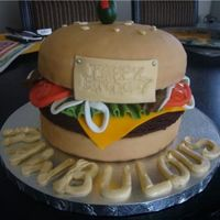 Cheeseburger Cake   my first 3d cake! bun is white cake & patty is a brownie! yummm