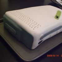 Xbox Cake   here is a 2 layer xbox cake.. white cake with cookies n cream filling and chocolate fudge buttercream =)