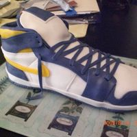 Air Jordan 1 Shoe Cake  this is an air jordan 1 shoe cake that i made for my friends birthday. he really likes the lakers so i decided to make it in the lakers...