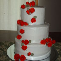 Roses This was my first wedding cake, it was for my niece. I loved doing it. Simple buttercream with gumpaste roses. Also my first attempt at...