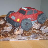 Monster Truck This was for my nephew's b-day. He loved it! I used the 3D car cruiser pan for the truck, the sand is brown sugar applied after...