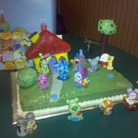 Blue's Clues Cake This was for my son's 1st birthday... all of the figures are plastic. The house is a tie dye lemon cake with lemon buttercream and the...
