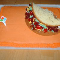Taco Cake This taco cake was made for my nephew. The sour cream is just buttercream, the cheese is yellow candy melts, shredded, the lettuce is candy...