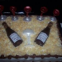 Chocolate Wine Bottles This is a coconut cake with shredded coconut on top tinted to look like wood shavings.