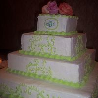 Lime Scrolls Square cake with lime colored scrolls and silver dragees.
