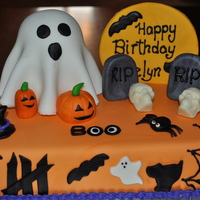 Ghostly Birthday 1/2 vanilla, 1/2 chocolate cake with fudge filling topped with MMF. Ghost is gluten free vanilla cake for one special girl. All sculptures...