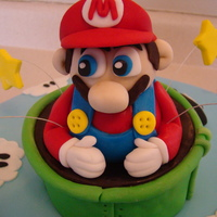 Super Mario sponge caked, butter icing and jam, covered in fondant.