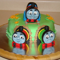 Thomas The Tank Engine And Freinds sponge cake, trains are sponge too. Butter icing and jam. Covered totally in fondant