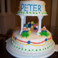 Clown Birthday Cake   2 tier cake, buttercream frosting clowns, fondant, chocolate and vanilla pudding filling
