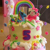 Hello Kitty, Unicorn, And Rainbow Cake 2 tier almond vanilla and chocolate cake with buttercream icing and fondant details. My 5 year old neice told me this was what she wanted.:...