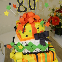 "3 Tier 80Th Birthday Square Present Cake 3 tier square cake 6"" lemon stand, 8"" key lime, 10"" orange creamsicle. Iced in decorators buttercream along with fondant/..."