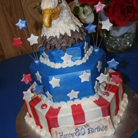 Patriotic 80Th Birthday Cake With 3D Eagles Head 3 tier hexagon cake with decorators buttercream and fondant details. Bottom tier was butter pecan flavored cake and the rest was almond...