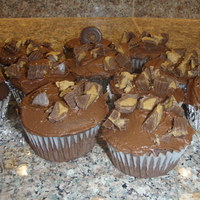 Peanut Butter Choc. Cupcakes Choc. cupcakes w/ peanut butter filling, choc. buttercream and topped with Reeses!! Yummy!!TFL