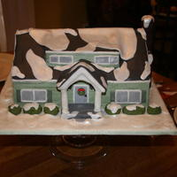 Grandmas House Green buttercream cake with fondant details.