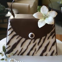 Kim's Purse Fondant covered chocolate mint cake with sugarpaste flowers and a sugar pearl bracelet.