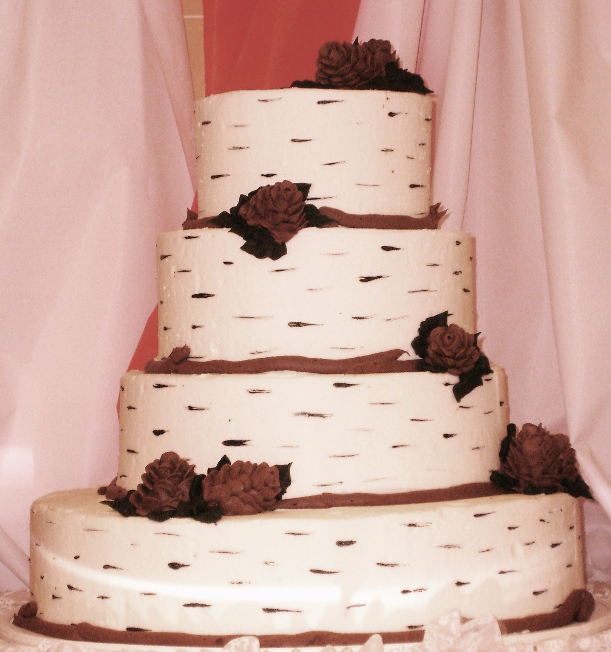 "Adirondack Wedding Cake   Adirondack style wedding cake, all made of buttercream ""birch bark"" and chocolate buttercream pine cones"