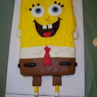 Spongebob Square Pants I made this for my son's second birthday party. I covered it in butter cream icing and then accented it with MMF.