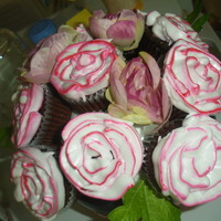 Cupcake Bouquet Cupcakes topped with boiled icing/ Italian meringue I included 3 artificial roses and leaves to enhance the presentation.