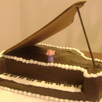 Piano Cake   I made this cake for my daughters piano teacher.They all loved it.