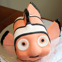Nemo Cake   Nemo cake made out of a 9x13 pan. Chocolate cake with vanilla bc and mmf.