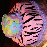 Hot Pink Zebra Cake   This is a almond cake with raspberry creme filling and almond BC and mmf.