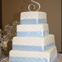 Square Quilted Wedding Cake  This is my first wedding cake I made for my cousins wedding. The top tier is princess flavor, the next one is red velvet, the 3rd tier is...