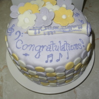 "Music Cake My co-worker's daughter made her school's Jazz Band as their only oboe player. This is a mini 6"" cake vanilla and chocolate..."