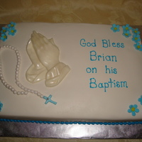 Brian's Baptism Cake This was a baptism cake for a 7 year old boy so I didn't want it to be too babyish. The cake is covered in Choco-Pan fondant with...