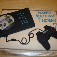 Playstation 2 Cake I made this cake for my 7 year old's birthday. The game on top was printed on edible paper, and the controller was made out of Rice...