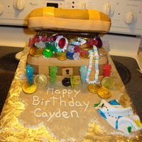 Treasure Chest   cake covered in fondant. used rock candy, choc coins, ring pops, and candy necklaces. brown sugar as sand