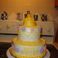 Belle   2 tier cake with mini wonder pan as belles dress. royal icing flowers, little belle doll