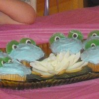 Frog Cupcakes Used Yellow cake, blue frosting, large green gum drops and one dark and one white chocolate chip. Grandkids loved these little frog...