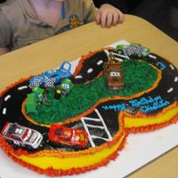 Pixar Movie Car Race Track Birthday Cake This is a Pixar Movie Car Race Track Birthday Cake. My three year old grandson Christian wanted the Pixar Movie Cars racing on his cake....