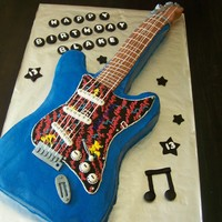 Blake's Electric Guitar Cake Electric Guitar Cake made to look just like the 13 yr old musician's real guitar!! Was sent photos and after seeing the real deal, was...