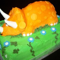 Orange Triceratops Cake Triceratops Cake made for a 4 yr old dinosaur fan. Cake is Funfetti with vanilla butter cream filling tinted orange like the triceratops....