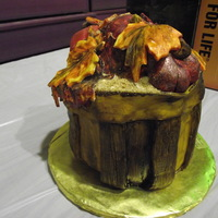 Autumn Pomegranate Basket Cake This Cake is Red Velvet with Butter Cream icing. The basket, fruit and fall oak leaves are satin fondant and hand painted.